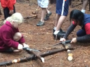 kids cutting wood for bowls